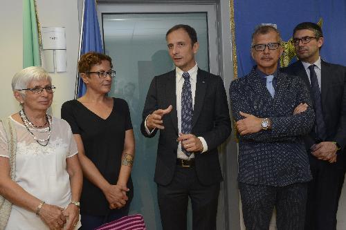 Il governatore Massimiliano Fedriga con Francesca Romoli alla cerimonia di intitolazione della sala del Consiglio delle Autonomie locali a Ettore Romoli - Udine 06/08/2018