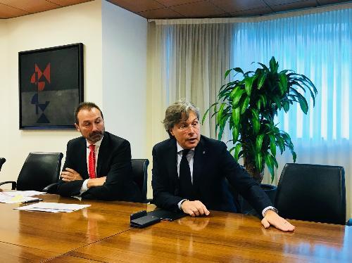 L'assessore regionale al Turismo Sergio Emidio Bini e il direttore generale di PromoTurismo Fvg Lucio Gomiero mentre presentano i dati turistici 2018 del Friuli Venezia Giulia, nella sede della Regione a Udine.