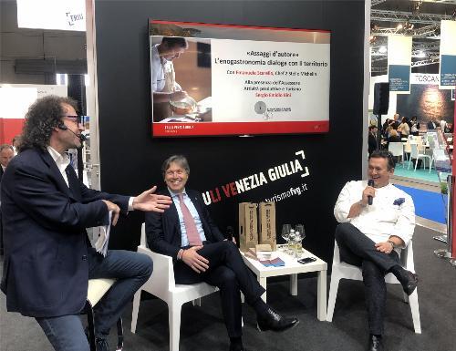 L'assessore regionale alle Attività produttive Sergio Emidio Bini con lo chef stellato Emanuele Scarello nello spazio espositivo del Friuli Venezia Giulia alla Borsa internazionale del turismo (Bit) di Milano.