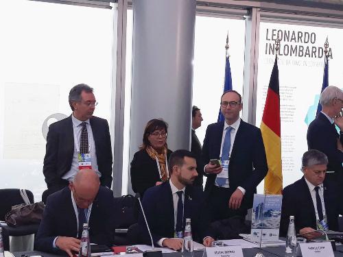 Un momento della riunione dell'assemblea generale della strategia macroregionale Eusalp. L'assessore a Infrastrutture e Territorio del Friuli Venezia Giulia, Graziano Pizzimenti in piedi a sinistra nella foto