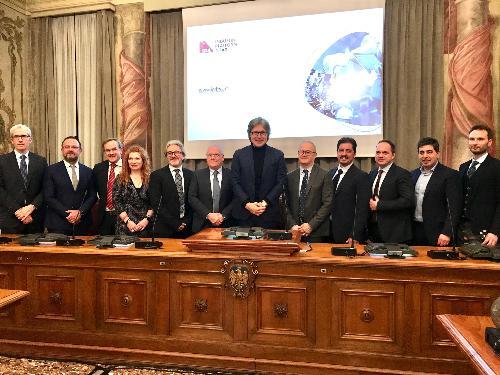 L'assessore alle Attività produttive del Fvg Sergio Emidio Bini con gli 11 premiati a Udine a palazzo Belgrado.
